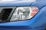 2014 Nissan Frontier SV Extended Cab Pickup Headlamp Detail